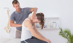 The woman receives chiropractic treatment.