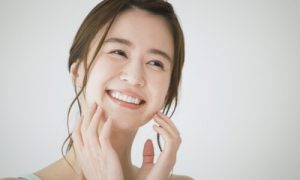 A woman smiling again after tooth restoration